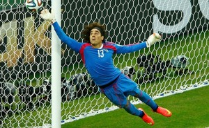 6.+Mexico's+Guillermo+Ochoa+jumps+to+save+the+ball+during+their+2014+World+Cup+Group+A