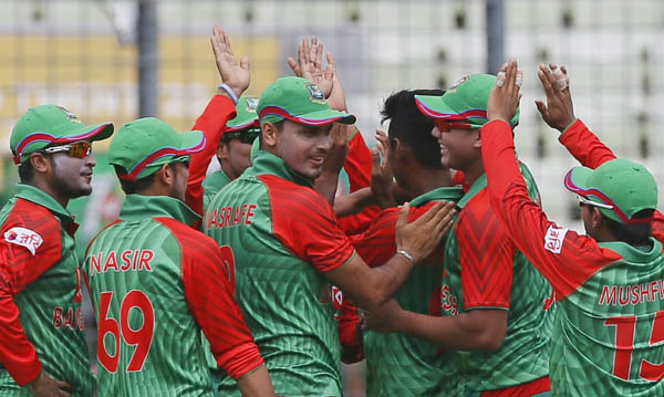 Bangladesh's players celebrate the dismissal of India's Rohit Sharma during their second one-day international cricket match in Dhaka, Bangladesh, Sunday, June 21, 2015. (AP Photo/ A.M. Ahad)